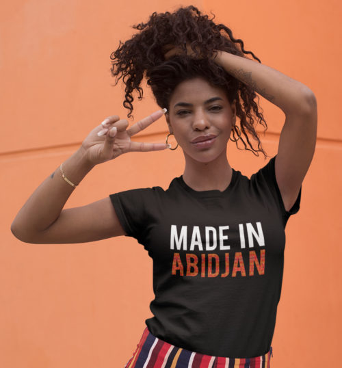 "Black woman wearing a black ""Made in Abidjan"" Tee shirt by Fashizblack"